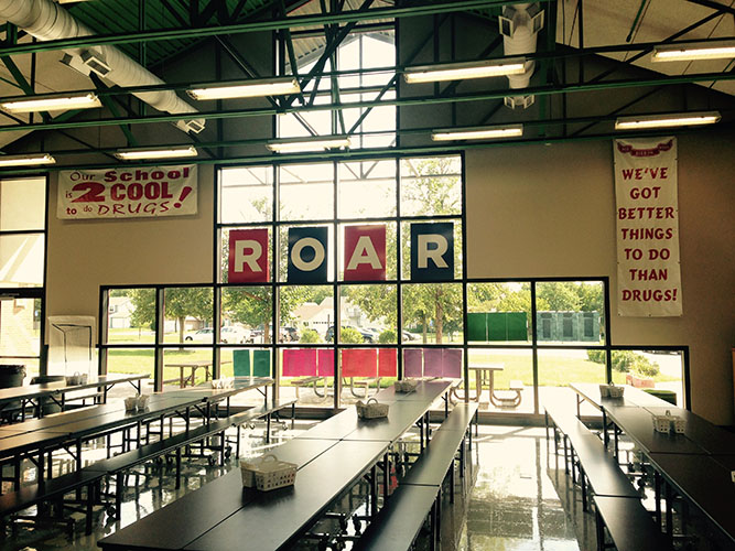 large ROAR sign in a cafeteria
