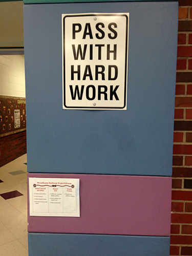 Pass with hard work sign