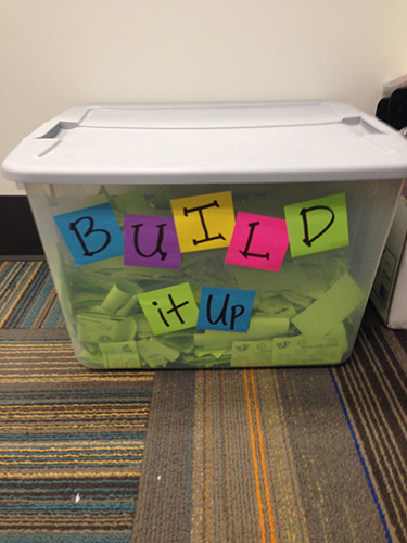 Tub of tickets that says BUILD it up