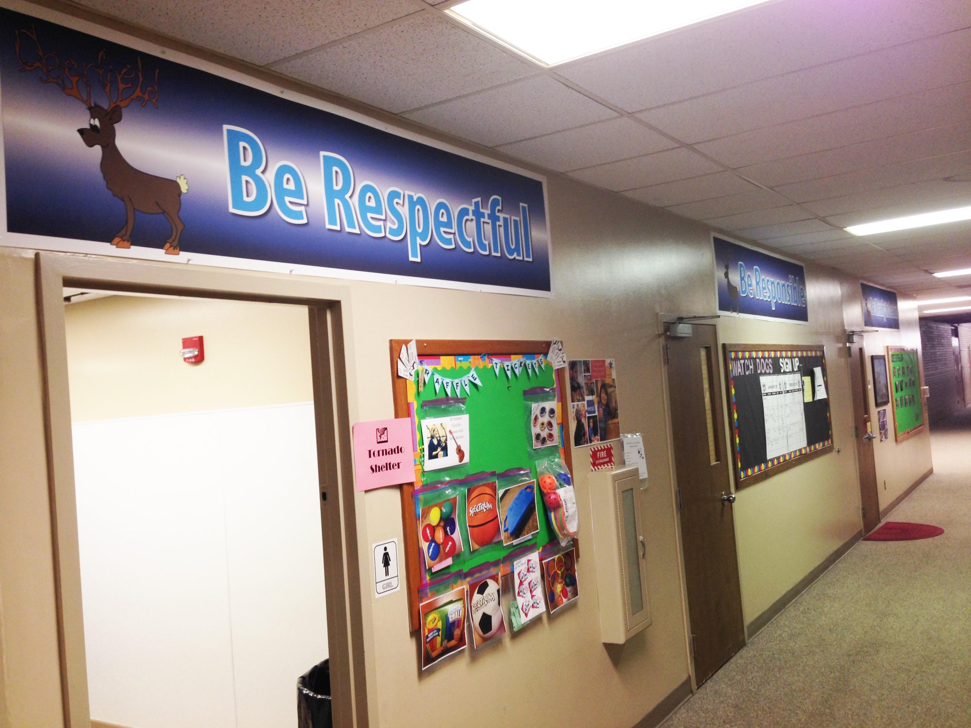 Be Respectull hallway banner above raffle ticket reward board